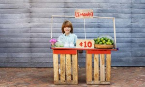 Boy Selling Lemonade on Stand